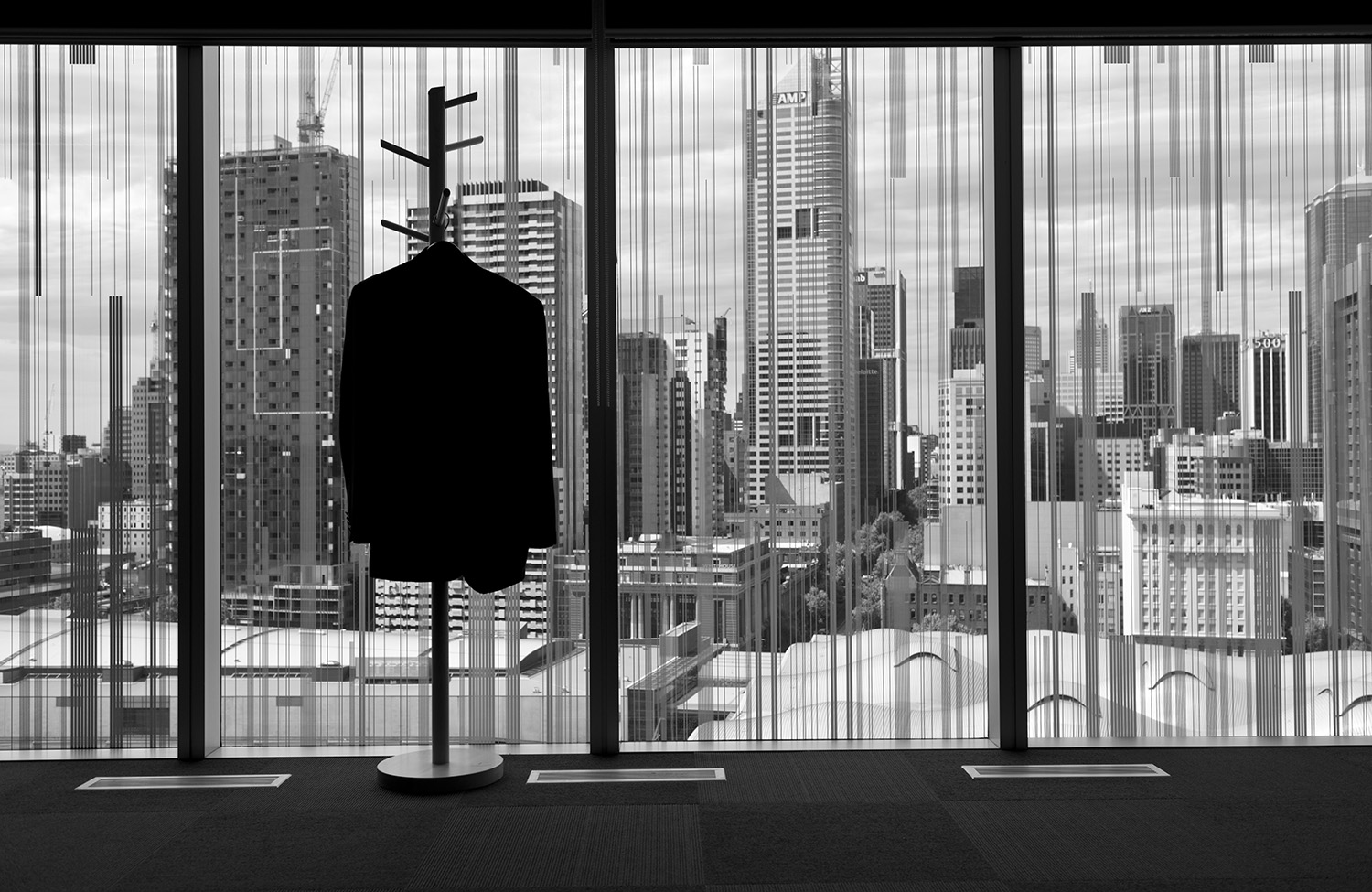 image of AARONTAIT COPYRIGHTED 2014 160 CORPORATE BUSINESS EXECUTIVES POWER COMMERCE DOCUMENTARY REPORTAGE OFFICE SILHOUETTE METAPHOR SUIT COAT VIEW PANORAMA
