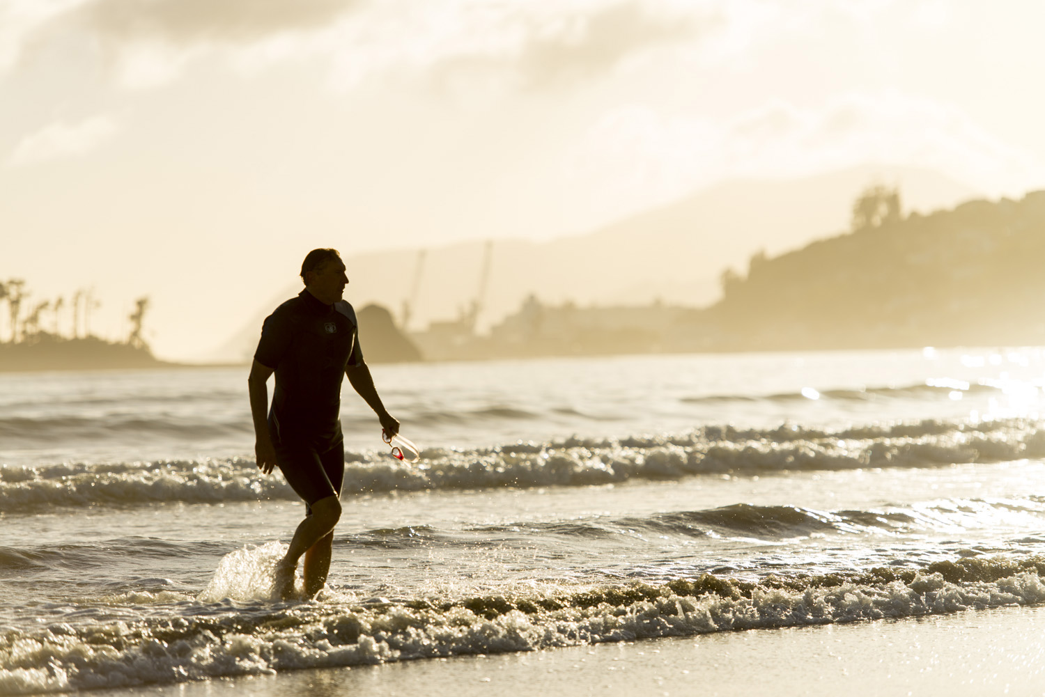 image of AARONTAIT COPYRIGHTED 2014 280 DOCUMENTARY PHOTOGRAPHER NEW ZEALAND EDITORIAL REPORTAGE CUSTOMER ENVIRONMENTAL HUMAN RESOURCES INTERVIEW REAL NATURAL LIGHT OCEAN SWIMMER LIFE HEALTH FITNESS BEACH