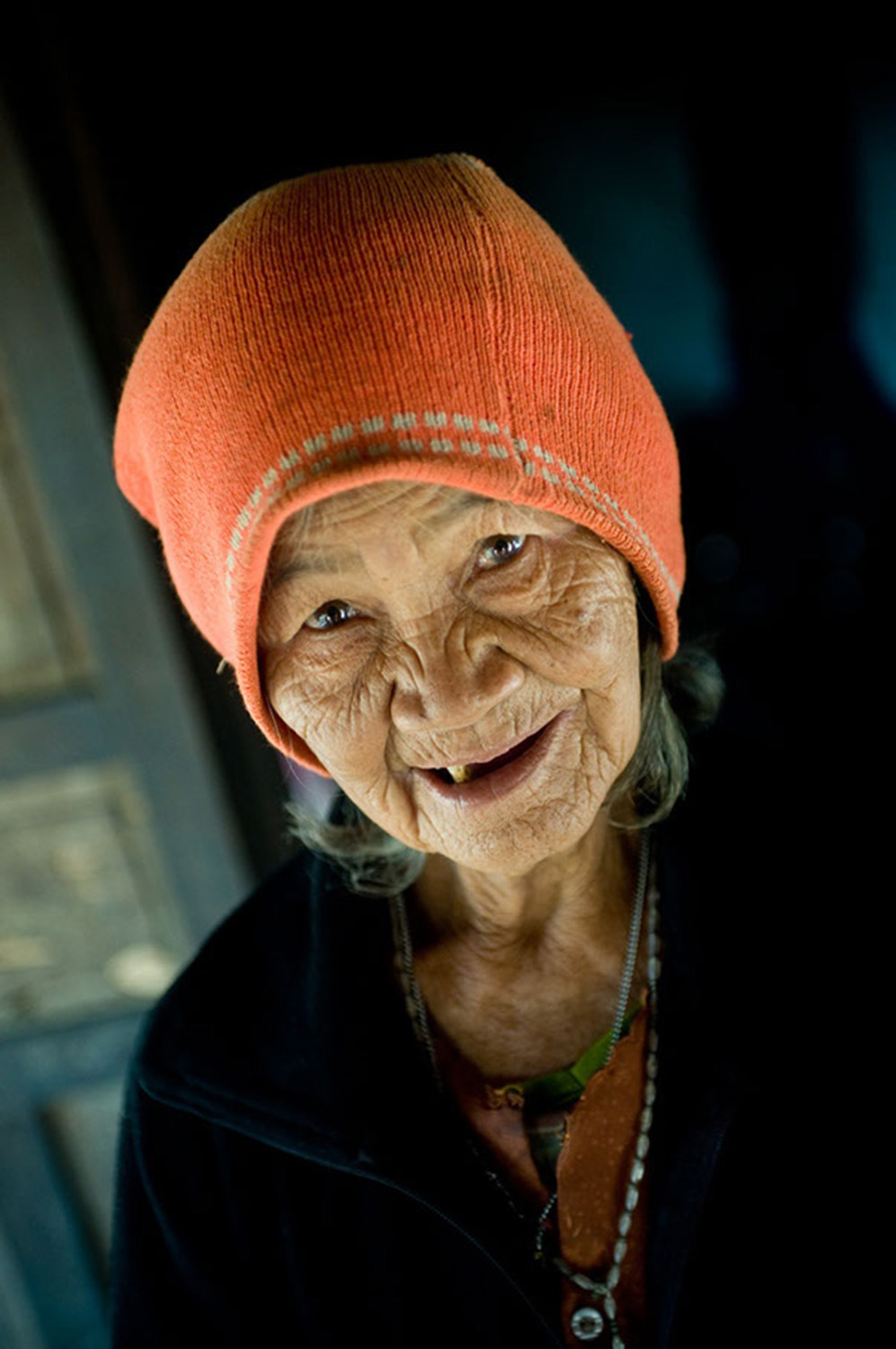 image of AARONTAIT COPYRIGHTED 2014 297I TRAVEL PHOTOGRAPHER ASIA REPORTAGE EDITORIAL STORY HUMANS LIFE EARTH TRAVELER EXPLORE CULTURE PEOPLE COUNTRY NATIONALITY DOCUMENTARY VIETNAM ELDER OLD LADY RURAL HAPPY