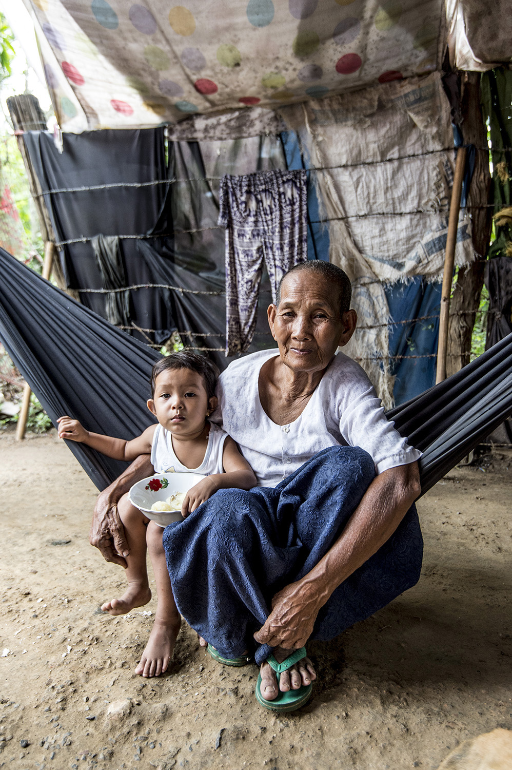 image of AARONTAIT COPYRIGHTED 2014 313 TRAVEL PHOTOGRAPHER ASIA REPORTAGE EDITORIAL STORY HUMANS LIFE EARTH TRAVELER EXPLORE CULTURE PEOPLE COUNTRY NATIONALITY DOCUMENTARY CAMBODIA VILLAGERS FAMILY ELDER