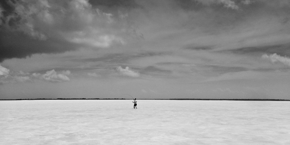 image of AARONTAIT COPYRIGHTED 2014 352 CHRISTMAS ISLAND KIRITIMATI KIRIBATI BONEFISH FLY FISHING BLACK WHITE LANDSCAPE SEASCAPE