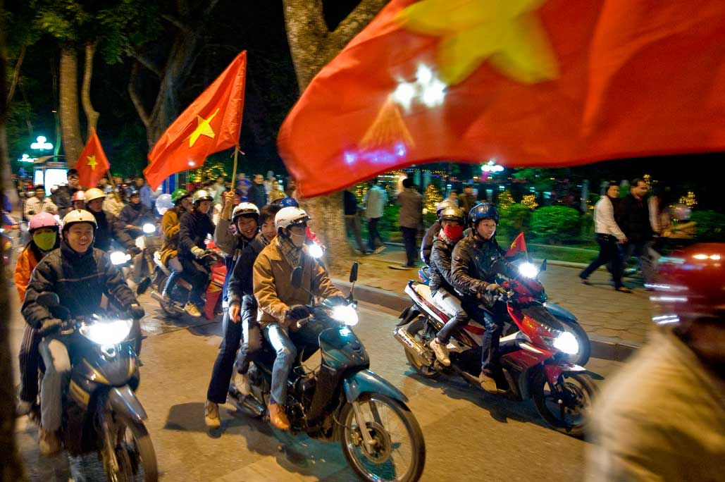 image of AARONTAIT COPYRIGHTED 2014 467 VIETNAM GLORY VICTORY FOOTBALL CELEBRATION HANOI FANS PATRIOTISM HAPPY RIOT FLARE DOCUMENTARY REPORTAGE PHOTOGRAPHER