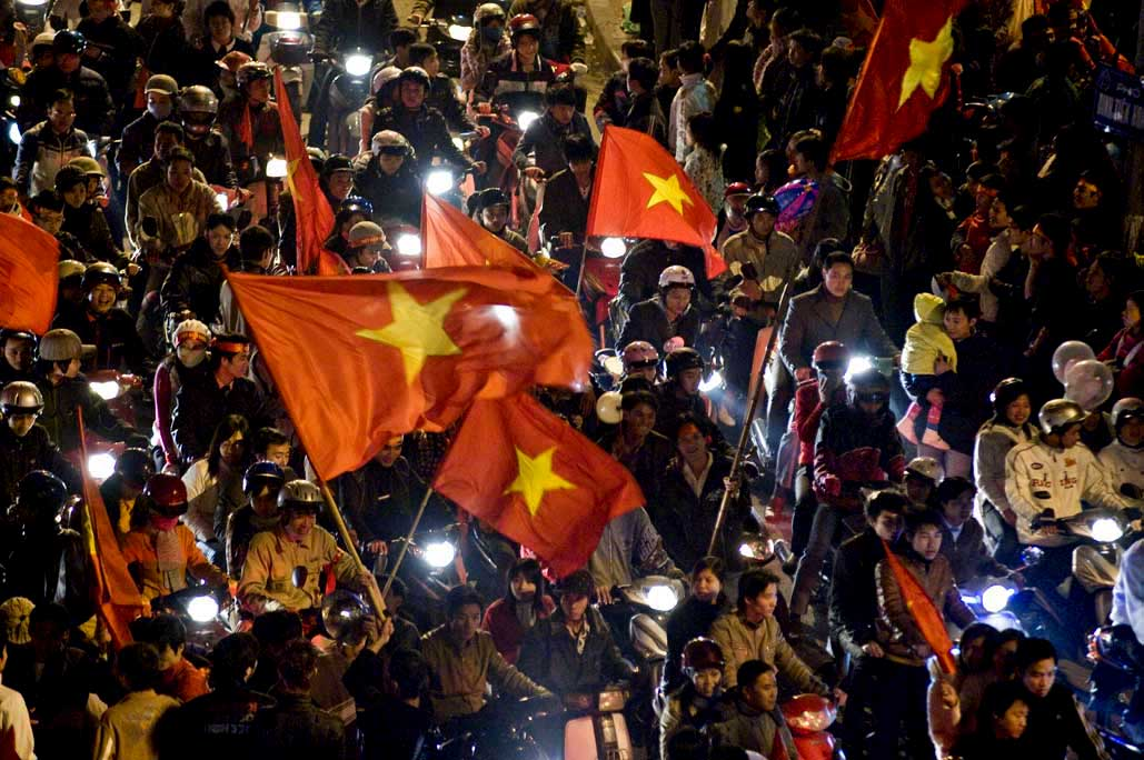 image of AARONTAIT COPYRIGHTED 2014 483 VIETNAM GLORY VICTORY FOOTBALL CELEBRATION HANOI FANS PATRIOTISM HAPPY RIOT FLARE DOCUMENTARY REPORTAGE PHOTOGRAPHER