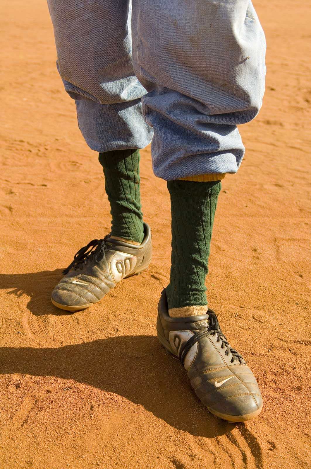 image of AARONTAIT-COPYRIGHTED-2014-5332 EDITORIAL DOCUMENTARY PHOTOGRAPHER PAPUNYA NORTHERN TERRITORY AUSTRALIA LANDSCAPE LIFE PEOPLE ART INDIGENOUS PINTUPI LURITJA PAPUNYA TULA FOOTY BOOTS AUSTRALIA OUTBACK