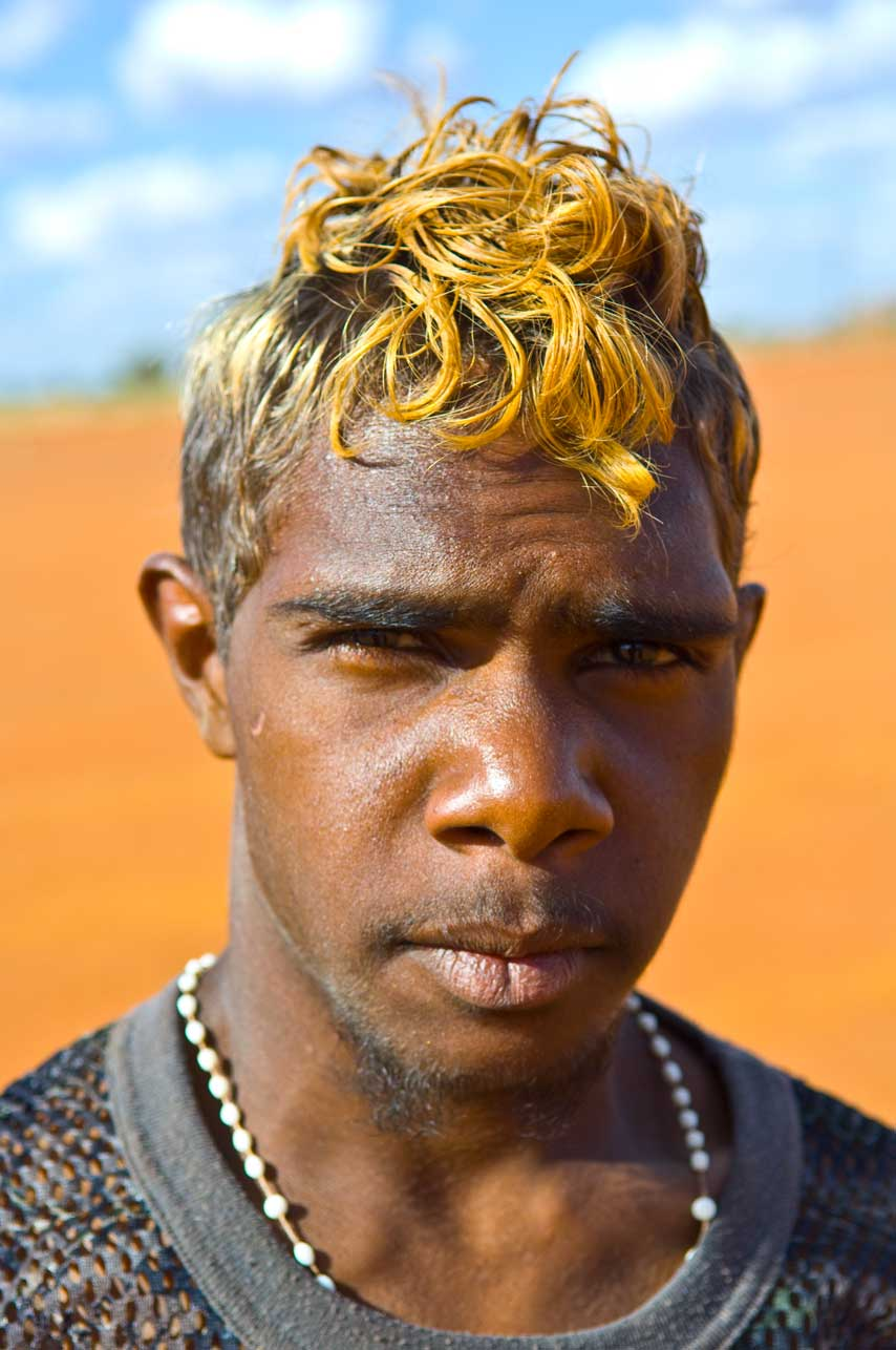 image of AARONTAIT COPYRIGHTED 2014 5342 EDITORIAL DOCUMENTARY PHOTOGRAPHER PAPUNYA NORTHERN TERRITORY AUSTRALIA LANDSCAPE LIFE PEOPLE ART INDIGENOUS PINTUPI LURITJA PAPUNYA TULA PORTAIT BOY